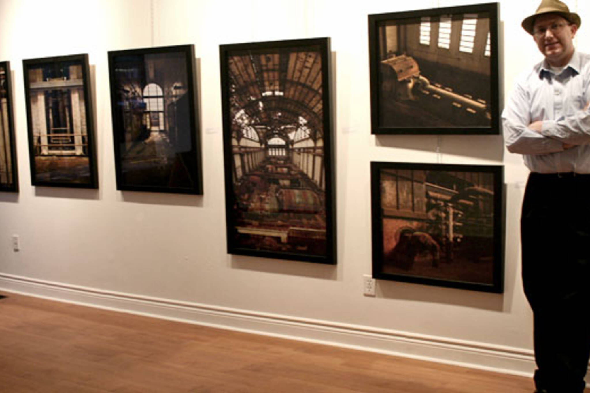 Sean Galbraith with his photographs, taken in Philadelphia
